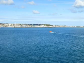 A tender boat heading to Guernsey